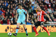 Joey Barton of Burnley (L) is put under pressure from Darron Gibson of Sunderland (R) during the Premier League match between Sunderland and Burnley at Stadium of Light on March 18, 2017 in Sunderland, England.