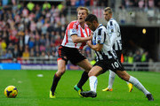 Newcastle player Hatem Ben Arfa (r) in action with Sebastian Larsson during the Barclays Premier League match between Sunderland and Newcastle United at Stadium of Light on October 27, 2013 in Sunderland, England.