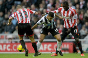 Hatem Ben Arfa (C) of Newcastle is challenged by Lee Cattermole (L) and Jozy Altidore of Sunderland during the Barclays Premier League match between Sunderland and Newcastle United at Stadium of Light on October 27, 2013 in Sunderland, England.
