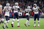 Tom Brady #12 of the New England Patriots high fives Dwayne Allen #83 after a  touchdown against the Philadelphia Eagles during the third quarter in Super Bowl LII at U.S. Bank Stadium on February 4, 2018 in Minneapolis, Minnesota.