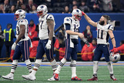 Julian Edelman #11 reacts with Tom Brady #12 of the New England Patriots after the Patriots defeat the Los Angeles Rams 13-3 during Super Bowl LIII at Mercedes-Benz Stadium on February 3, 2019 in Atlanta, Georgia.