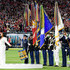 Demi Lovato Photos - Demi Lovato performs the National Anthem onstage during Super Bowl LIV at Hard Rock Stadium on February 02, 2020 in Miami Gardens, Florida. - Super Bowl LIV Pregame