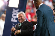 Former NFL head coach and Fox Sports analyst Jimmy Johnson talks with former NFL player and Fox Sports analyst Michael Strahan prior to Super Bowl LIV between the San Francisco 49ers and the Kansas City Chiefs at Hard Rock Stadium on February 02, 2020 in Miami, Florida.