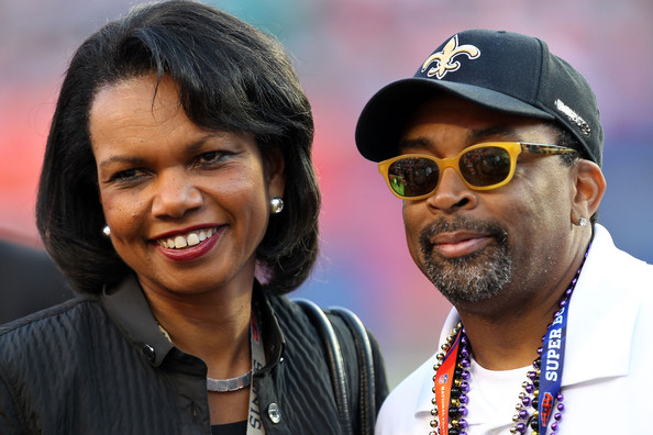 Former Secretary of State Condoleezza Rice and Director Spike Lee watch warms-ups on the field prior to the start of Super Bowl XLIV between the Indianapolis Colts and the New Orleans Saints on February 7, 2010 at Sun Life Stadium in Miami Gardens, Florida.