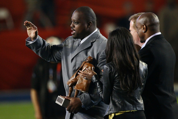 Brian Waters of the Kansas City Chiefs accepts the Walter Payton Man of the Year Trophy prior to Super Bowl XLIV between the Indianapolis Colts and the New Orleans Saints on February 7, 2010 at Sun Life Stadium in Miami Gardens, Florida.