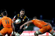 Liam Messam of the Chiefs is tackled  during the round 12 Super Rugby match between the Chiefs and the Jaguares at Rotorua International Stadium on May 4, 2018 in Rotorua, New Zealand.