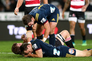 Teihorangi Walden of the Highlanders congratulates Ben Smith on hus try during the round 12 Super Rugby match between the Highlanders and the Lions at Forsyth Barr Stadium on May 12, 2018 in Dunedin, New Zealand.