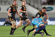 Liam Messam of the Chiefs is tackled by Bryn Gatland of the Blues during the round two Super Rugby match between the Blues and the Chiefs at Eden Park on March 2, 2018 in Auckland, New Zealand.