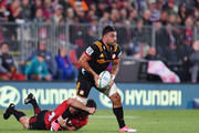 Liam Messam of the Chiefs offloads the ball during the round two Super Rugby match between the Crusaders and the Chiefs at AMI Stadium on February 24, 2018 in Christchurch, New Zealand.