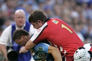 Bjorn Basson of the Bulls is tackled by JC Janse van Rensburg during the Vodacom Super Rugby match between Vodacom Bulls and Lions from Loftus Versfeld Stadium on March 26, 2011 in Pretoria, South Africa.
