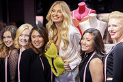 """Supermodel Romee Strijd poses for a photo with Victoria's Secret Bra Fit Experts as they celebrate the all new """"Body By Victoria"""" collection on August 14, 2018 in Dallas, Texas."""