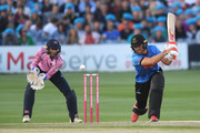 Laurie Evans of Sussex hits out with wicketkeeper John Simpson of Middlesex during the Vitality Blast match between Sussex Sharks and Middlesex at The 1st Central County Ground on August 17, 2018 in Hove, England.