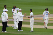 Umpire Neil Mallender discusses a disputed slip catch with Mohammad Abbas of Leicestershire as Ben Brown of Sussex looks on during the Specsavers County Championship Division Two between Sussex and Leicestershire at The 1st Central County Ground on September 4, 2018 in Hove, England.