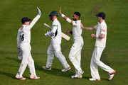Ajmal Shazad of Sussex celebrates with team mates Ben Brown (L) and Steve Magoffin after dismissing Alexei Kervezee of Worcestershire for 93 during the LV County Championship match between Sussex and Gloucestershire at BrightonandHoveJobs.com County Ground on April 20, 2015 in Hove, England.