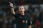 Referee Mike Dean during the Premier League match between Swansea City and Brighton and Hove Albion at the Liberty Stadium on November 4, 2017 in Swansea, Wales.