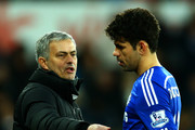Jose Mourinho, manager of Chelsea speaks with Diego Costa as he is substituted during the Barclays Premier League match between Swansea City and Chelsea at Liberty Stadium on January 17, 2015 in Swansea, Wales.