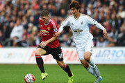 Bastian Schweinsteiger of Manchester United is closed down by Sung-Yeung Ki of Swansea City during the Barclays Premier League match between Swansea City and Manchester United at Liberty Stadium on August 30, 2015 in Swansea, Wales.