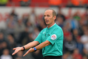 Referee Mike Dean during the Barclays Premier League match between Swansea City and Tottenham Hotpsur at the Liberty Stadium on October 4, 2015 in Swansea, United Kingdom.