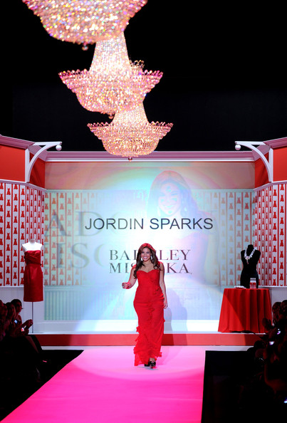 Singer Jordin Sparks walks the runway during Swarovski at the Red Dress Collection 2010 Fashion Show during Mercedes-Benz Fashion Week at The Tent at Bryant Park on February 11, 2010 in New York City.