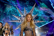 Romee Strijd walks the runway wearing the Swarovski Crystal Embellished Mesh Bodysuit and Wing in the 2018 Victoria's Secret Fashion Show at Pier 94 on November 8, 2018 in New York City.