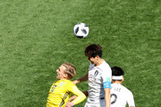 Emil Forsberg of Sweden jumps for a header with Ki Sung-Yueng and Yong Lee of Korea Republic during the 2018 FIFA World Cup Russia group F match between Sweden and Korea Republic at Nizhniy Novgorod Stadium on June 18, 2018 in Nizhniy Novgorod, Russia.
