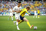 Yong Lee of Korea Republic challenges Emil Forsberg of Sweden during the 2018 FIFA World Cup Russia group F match between Sweden and Korea Republic at Nizhniy Novgorod Stadium on June 18, 2018 in Nizhniy Novgorod, Russia.