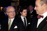 King Carl XVI Gustaf of Sweden (L) speaks with Estonian President Toomas Hendrik Ilves (R) and as Prince Carl Philip of Sweden (C) finds his seat at a reception at Operaterrassen on the second day of the Estonian state visit on January 19, 2011 in Stockholm, Sweden.