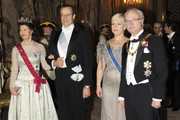 Queen Silvia of Sweden, Estonian President Toomas Hendrik Ilves, Estonian First Lady Evelin Ilves and King Carl XVI Gustaf of Sweden arrive at a banquet hosted by the Royal Family at the palace on the first day of the Estonian state visit on January 18, 2011 in Stockholm, Sweden.
