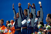 (L-R) Gold medallists Ryan Lochte, Nathan Adrian, Simone Manuel and Missy Franklin of the United States celebrate during the medal ceremony after setting a new world record of 3:23.05 in the Mixed 4x100m Freestyle Relay Final on day fifteen of the 16th FINA World Championships at the Kazan Arena on August 8, 2015 in Kazan, Russia.
