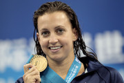 Gold medalist Rebecca Soni of the United States poses with her medal after the Women's 200m Breaststroke Final during Day Fourteen of the 14th FINA World Championships at the Oriental Sports Center on July 29, 2011 in Shanghai, China.