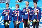 (L-R) Michael Phelps, Ryan Lochte, Mattew Grevers and Nathan Adrian of the United States receive the gold medal during the medal ceremony for the Men's 4x 100m Freestyle Final  during the 13th FINA World Championships at the Stadio del Nuoto on July 26, 2009 in Rome, Italy.