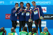 (L-R) Michael Phelps, Nathan Adrian, Ryan Lochte and Mattew Grevers of the United States smile as they receive the gold medal during the medal ceremony for the Men's 4x 100m Freestyle Final during the 13th FINA World Championships at the Stadio del Nuoto on July 26, 2009 in Rome, Italy.