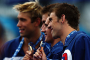 (L-R)  Mattew Grevers, Nathan Adrian, Ryan Lochte and Michael Phelps of the United States smiles as they receive the gold medal during the medal ceremony for the Men's 4x 100m Freestyle Final during the 13th FINA World Championships at the Stadio del Nuoto on July 26, 2009 in Rome, Italy.
