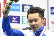 Kosuke Kitajima of Japan celebrates on the podium after winning the bronze medal for men 100m Breaststroke during day one of the Japan Open 2014 at Tokyo Tatsumi International Swimming Pool on June 19, 2014 in Tokyo, Japan.