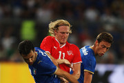 Marco Padalino of Switzerland battles with of Giuseppe Rossi and Claudio Marchisio Italy during the International Friendly between Switzerland and Italy at St. Jakob-Park on August 12, 2009 in Basel, Switzerland.