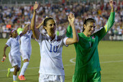Carli Lloyd #10 and Hope Solo #1 of the U.S. women's national team salute the fans after a 4-1 win over the Swiss women's national team during their match at WakeMed Soccer Park on August 20, 2014 in Cary, North Carolina.