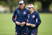 Roosters assistant coaches Craig Fitzgibbon (L) and Jason Taylor (R) look on during a Sydney Roosters NRL training session at Moore Park on March 19, 2013 in Sydney, Australia.