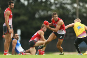 Josh Kennedy takes on Daniel Hanneberry during a Sydney Swans AFL training session at Lakeside Oval on April 1, 2014 in Sydney, Australia.