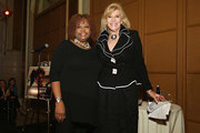 Host Robin Quivers poses for a photo with President and CEO of Scenterprises/ honoree Sue Phillips during the T.J. Martell Foundation 4th Annual Women Of Influence Awards on May 13, 2016 in New York, New York.
