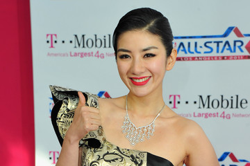 Huang Yi T-Mobile Magenta Carpet At The NBA All-Star Game - Arrivals