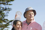 Actor Bill Murray puts the trophy on 3M Senior Vice President of Corporate Affairs Denise Rutherford's head after the 3M Celebrity Challenge prior to the AT&T Pebble Beach Pro-Am at Pebble Beach Golf Links on February 05, 2020 in Pebble Beach, California.