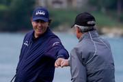 Phil Mickelson of the United States congratulates Scott Ozanus, Deputy Chairman and Chief Operating Officer of KPMG, on his shot from the seventh tee during the third round of the AT&T Pebble Beach Pro-Am at Pebble Beach Golf Links on February 09, 2019 in Pebble Beach, California.