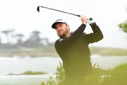 Graeme McDowell of Northern Ireland plays his shot from the 13th tee during the second round of the AT&T Pebble Beach Pro-Am at Monterey Peninsula Country Club Shore Course on February 08, 2019 in Pebble Beach, California.