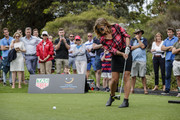 Snowboarder Torah Bright tees-off at the Tag Heuer Hole in One Challenge at the Royal Sydney Golf Club on November 19, 2016 in Sydney, Australia.  The ball cannoned into the shins of a Channel 7 cameraman.