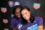Orlando Pride player, Ali Krieger (R) takes a selfie during the kick-off of the Tag Heuer new partnership with Orlando City SC & Orlando Pride on May 3, 2018 in New York City.