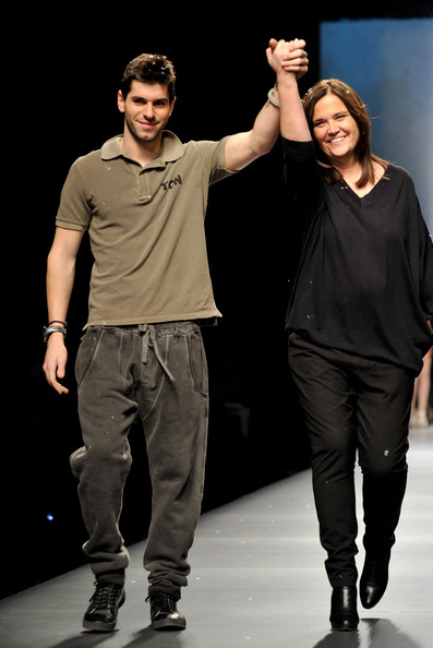 Designer Toton Comella (R) and Jaime Alguersuari walk the runway at the TCN show during Cibeles Madrid Fashion Week Autumn/Winter 2010 on February 22, 2010 in Madrid, Spain.