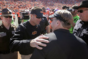 Head Coach Mike Gundy of the Oklahoma State Cowboys meets Head Coach Gary Patterson of the TCU Horned Frogs after their game October 19, 2013 at Boone Pickens Stadium in Stillwater, Oklahoma. The Cowboys defeated the Horned Frogs 24-10.