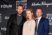 (L-R) Actors Jai Courtney, Melissa George and Joel Edgerton arrive at the TIFF HFPA / InStyle Party during the 2013 Toronto International Film Festival at Windsor Arms Hotel on September 9, 2013 in Toronto, Canada.