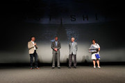 Executive Producer Steven Kane (L), The Secretary of the Navy Ray Mabus (C-R) and Admiral Dawn Cutler (R) present actor Eric Dane with a Shadow Box containing Navy medals earned by his father at the TNT 'The Last Ship' Washington D.C. Screening at The Newseum on June 12, 2015 in Washington, DC.