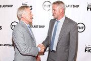 Actor Eric Dane (R) greets the Secretary of the Navy Ray Mabus at the TNT 'The Last Ship' Washington D.C. Screening at The Newseum on June 12, 2015 in Washington, DC.